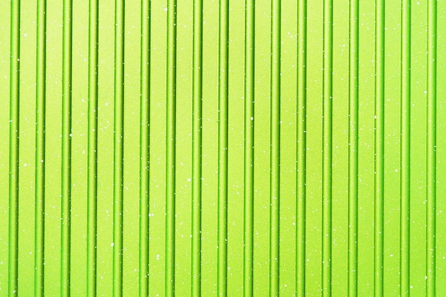 Bright abstract light green striped background. texture of grill pan.