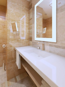 Bright bathroom trend and amber color tile with snowy-white countertop of sink console and mirrors with frame light.