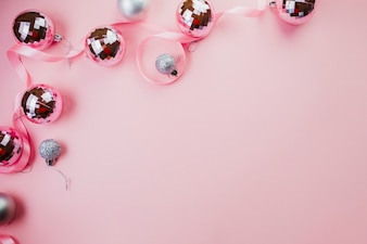 Bright baubles on pink background