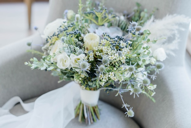 Bright beautiful bridal bouquet with white flowers