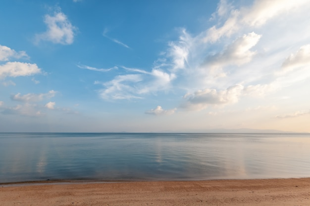 Bright beautiful seascape, sandy beach, clouds reflected in the water, natural minimalistic