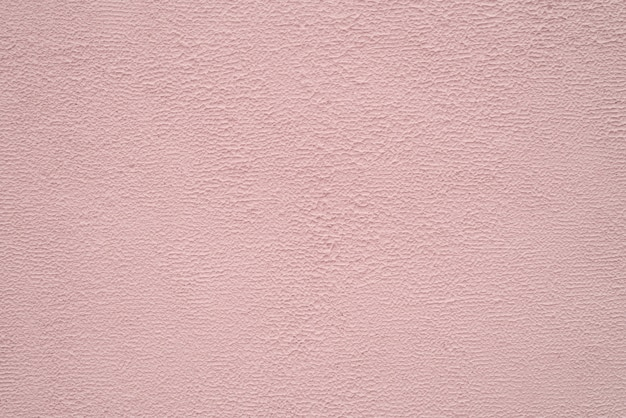 Bright beige and peach fine texture of plaster. background.