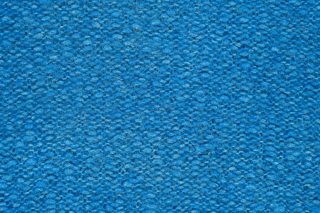 Bright blue knitted texture. handmade knitwear.