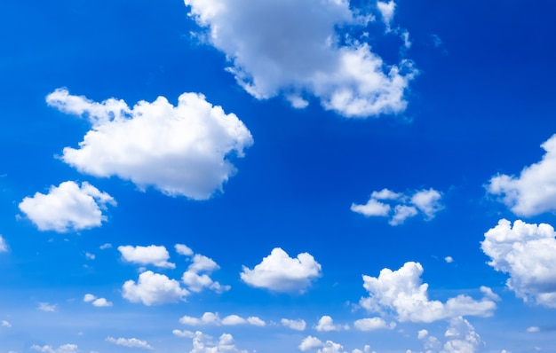 Bright blue sky background with clouds