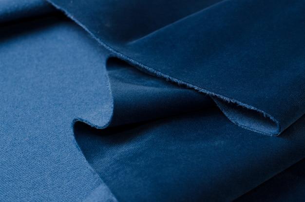 Bright blue velour textile sample. fabric texture