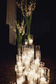 Bright candles burn standing on the floor