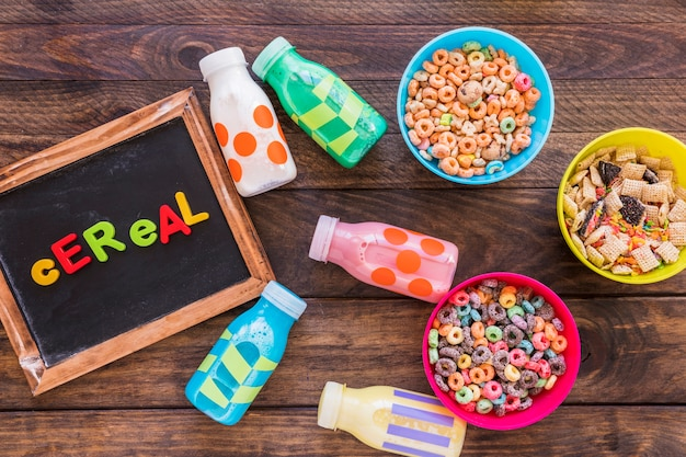 Bright cereal inscription on wooden chalkboard