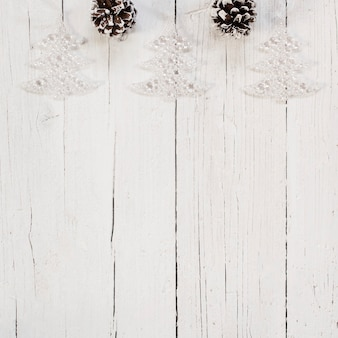 Bright christmas tree ornaments over white background