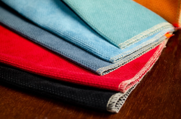 Bright collection of colorful gunny textile samples. fabric texture