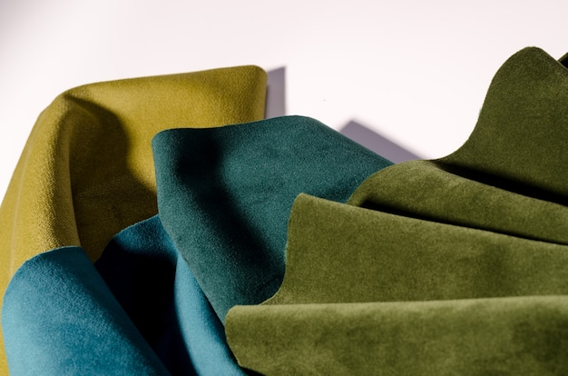 Bright  collection of emerald velvet textile samples in green colors. fabric texture