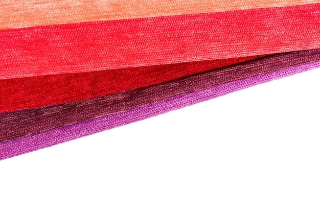 布のクローズアップの明るいコレクション。コピースペースと布の背景