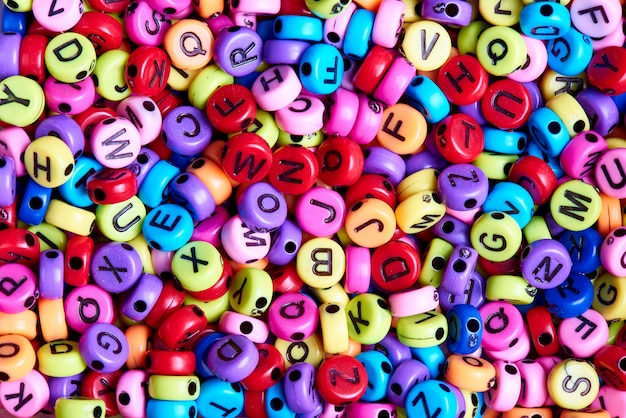 Bright colored beads with english letters close-up.