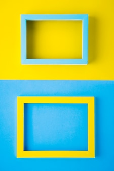 Bright colored frames on bicolor background