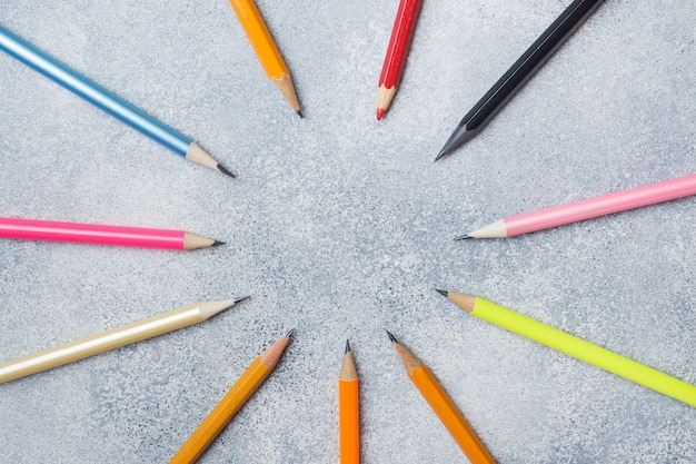 Bright colored pencils on the grey table. concept school. copy space