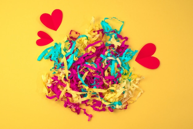 Bright colored serpentine red heart on a colorful yellow background
