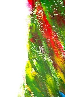 液体塗料の明るくカラフルな線の明るくカラフルな背景。ブラシストロークと白の背景に明るい緑、赤の線のブラシストローク。カンバの液体塗料。クローズアップスプラッタストローク