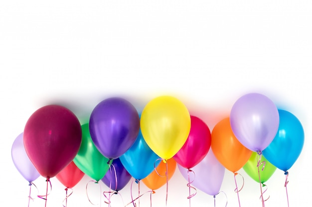 Bright colorful balloons under ceiling copy space