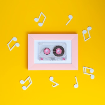 Bright colorful cassette tape with musical notes around it