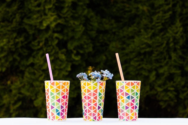 Bright colorful glasses, dishes for a picnic, summer glasses. copy space.
