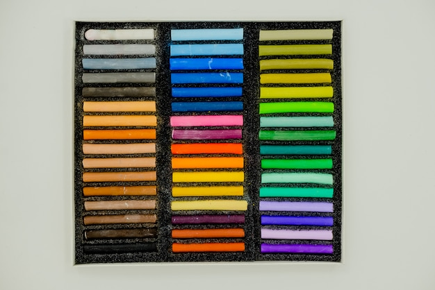 Bright colorful pastel  multicolored pastel crayons in openartist box