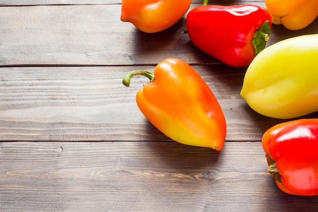 Bright colorful ripe bell pepper on the background of a wooden table