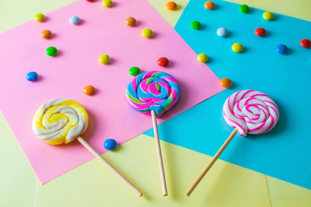 Bright colorful sweet lollipops background
