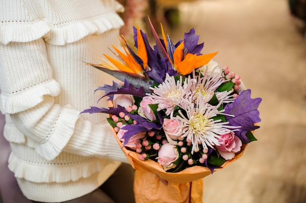 Bright and colorful valentine bouquet in womans hands