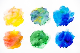 Bright colorful watercolor splatter on white background