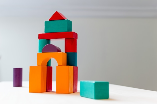 Bright colorful wooden blocks toy. bricks children building tower, castle, house.