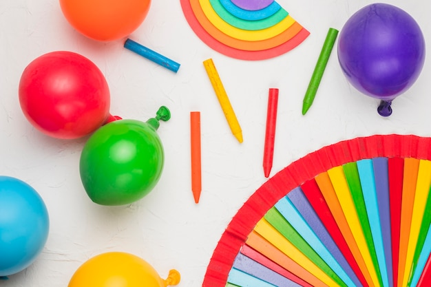 Bright composition of balloons pencils as lgbt symbols