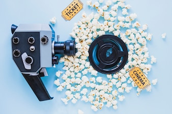 Bright composition of camera and popcorn