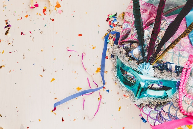 Bright costume with mask in confetti
