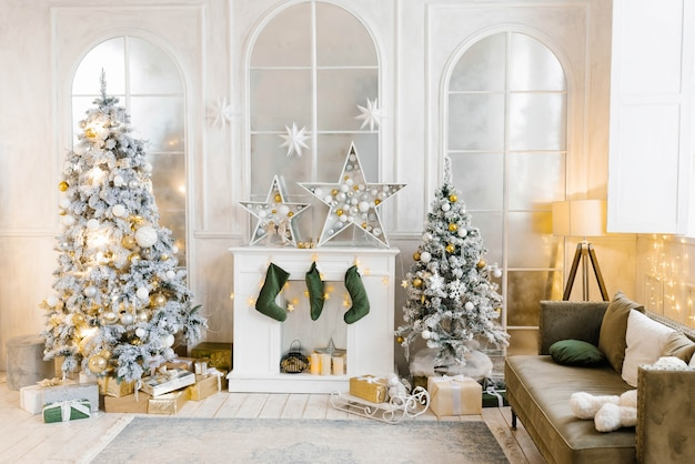 Bright cozy living room with a large elegant christmas tree, decorated for christmas