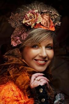 明るくクリエイティブなメイク。美しい女性の顔。秋のスタイル。