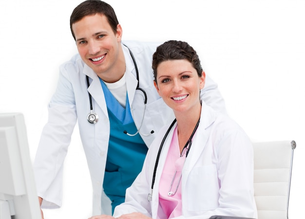 Bright doctor and nurse working at computer