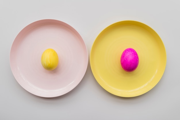 Bright easter eggs on plates