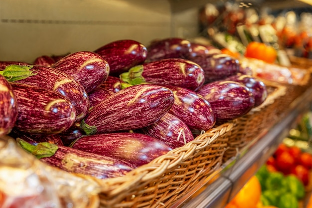 Bright eggplants on a store counter. close-up. side view. vegetarianism and malnutrition.