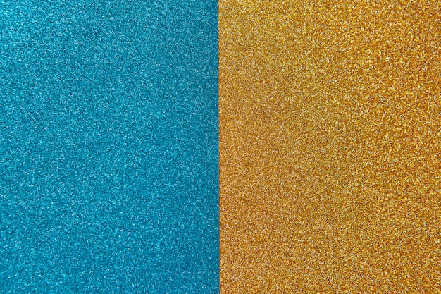 Bright festive brilliant background, consisting of two halves, blue and gold. horizontal.