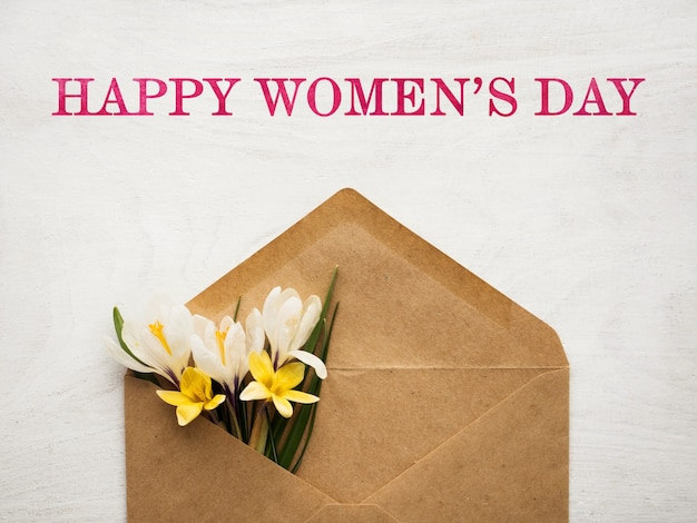 Bright flowers and happy women's day lettering. close-up, no people. congratulations for family, relatives, friends and colleagues