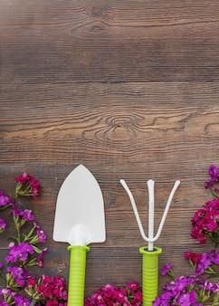 Bright flowers near gardening tools