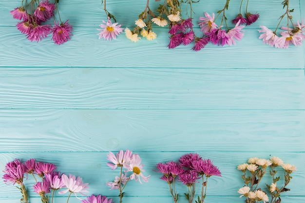 Bright flowers scattered on table