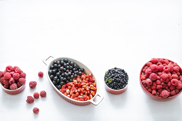 Bright fresh wild berries isolated top view. the concept of healthy eating.