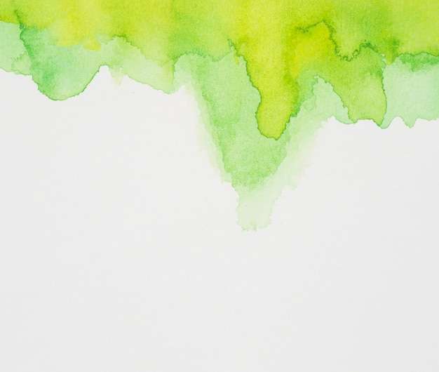 Bright green mix of paints on white paper