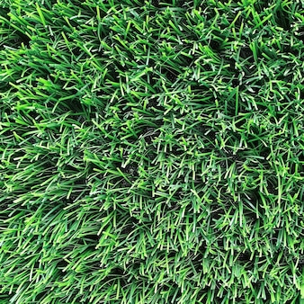Bright green natural background. artificial grass close-up.