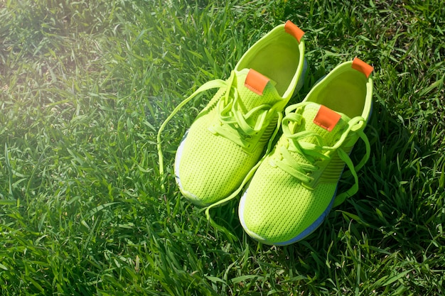 Bright green sneakers on grass