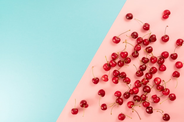 Bright juicy cherry berries on a colored background