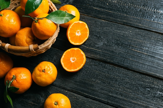 Bright juicy tangerines closeup with copy space