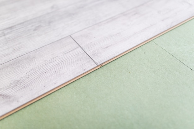 Bright laminated flooring boards on gray