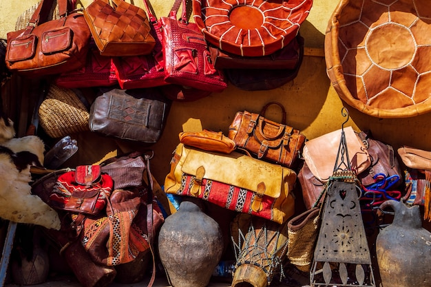 Bright leather bags on the moroccan market. handmade souvenirs, fez, morocco.