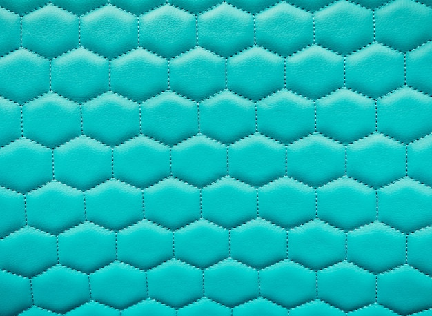 Bright leather hexagon texture background. honeycombs quilted